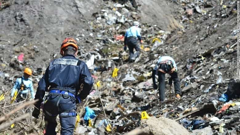 French rescue workers sift through the remains of Germanwings Flight 9525 in the French Alps.