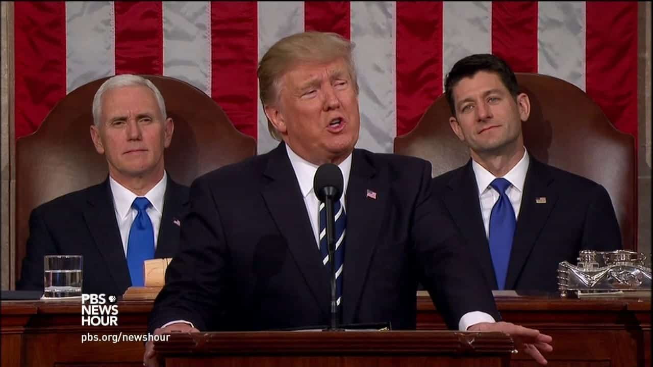 Flanked by Mike Pence and Paul Ryan, Donald Trump speaks before Congress in early 2017.