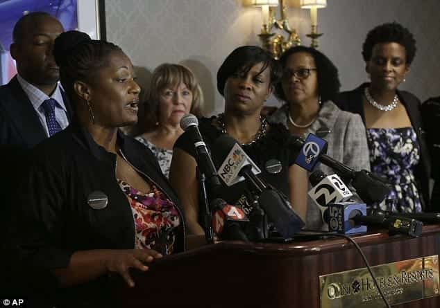 Image of Brown and Tichaona and a news conference