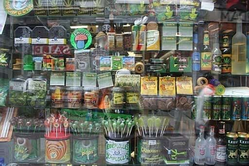 Amsterdam store window displaying various medical cannabis, hemp food and other types of products; image by nickolette, CC BY 2.0, via Wikimedia Commons, no changes.