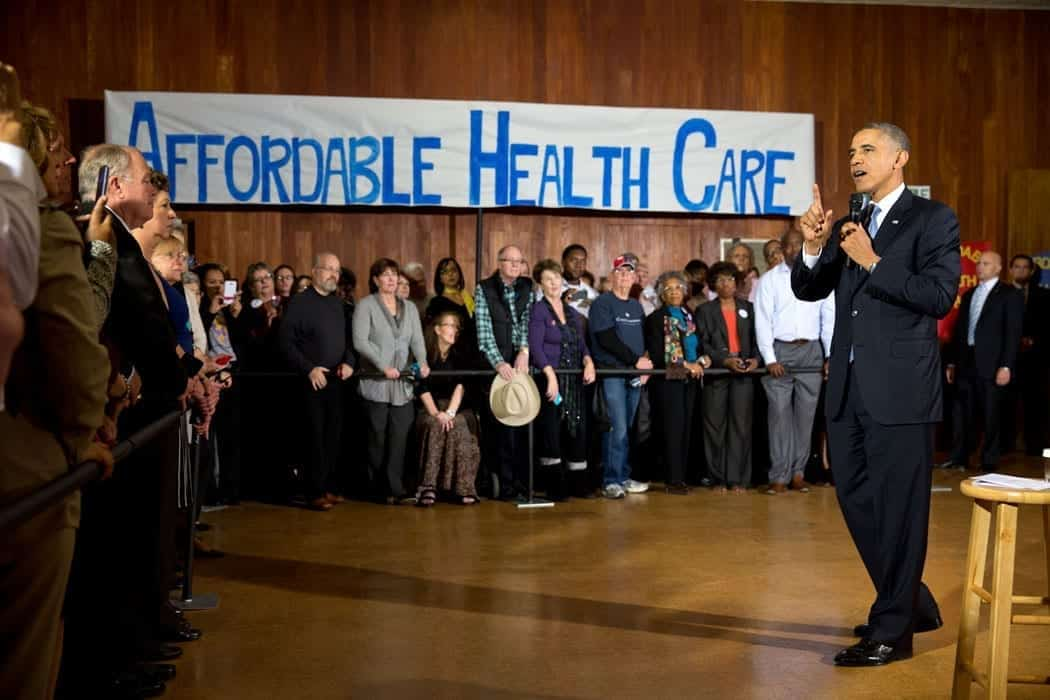 Then-President Barack Obama delivers remarks at an Affordable Care Act event at Temple Emanu-El in Dallas, Texas, Nov. 6, 2013. Official White House Photo by Pete Souza, Public domain.