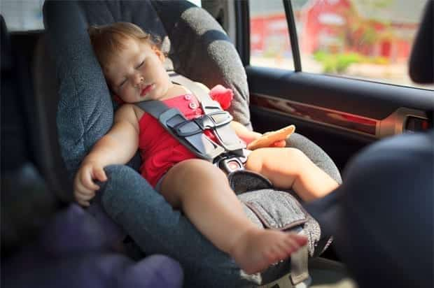 Baby sleeping in the backseat of a car; image courtesy of www.salon.com.