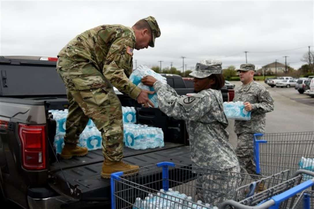 Members of the Texas National Guard load a truck with bottled water to assist with the Flint water crisis.