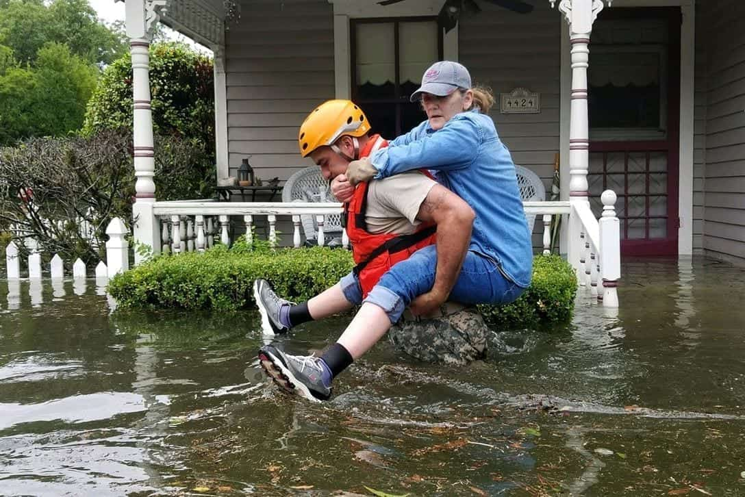 A Texas National Guardsman carries a resident through the Houston floodwater.