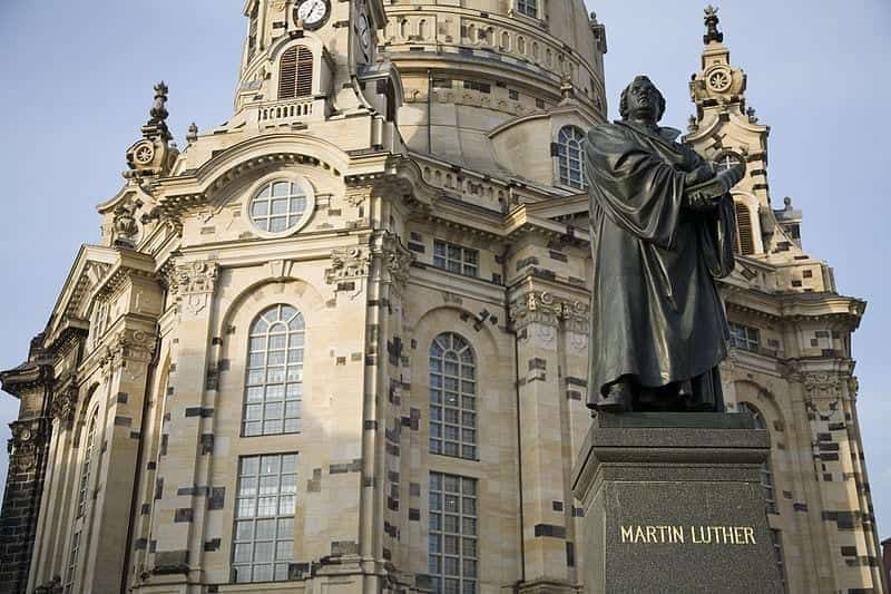 A statue of Martin Luther, who sparked the Protestant Reformation, stands in front of the rebuilt Frauenkirche in Dresden, Germany.