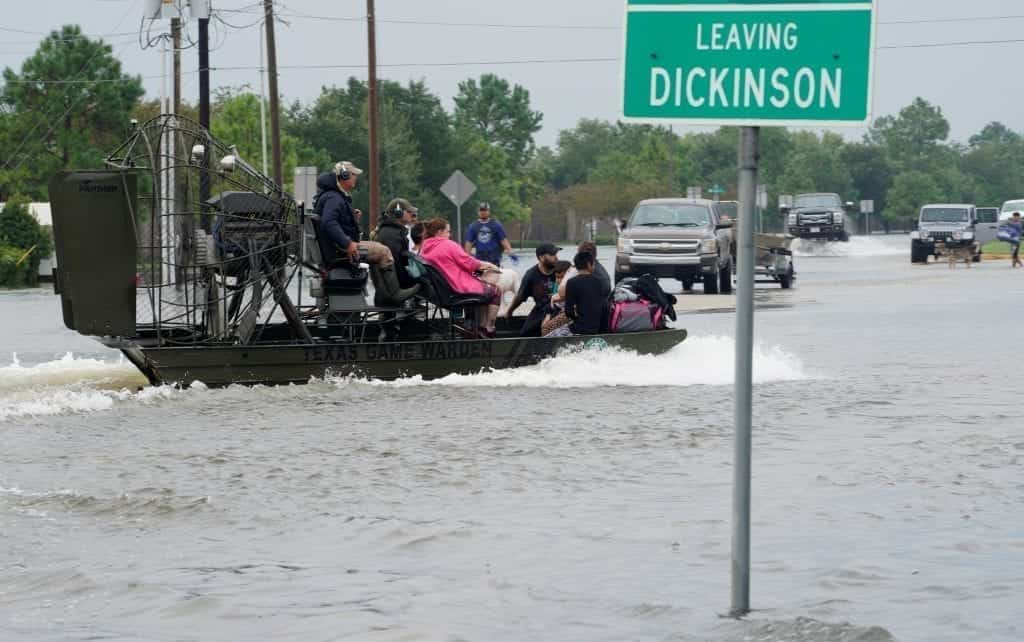 People are rescued by airboat as they evacuate from flood waters from Hurricane Harvey in Dickinson, Texas August 27, 2017. (Photo: Rick Wilking/REUTERS)