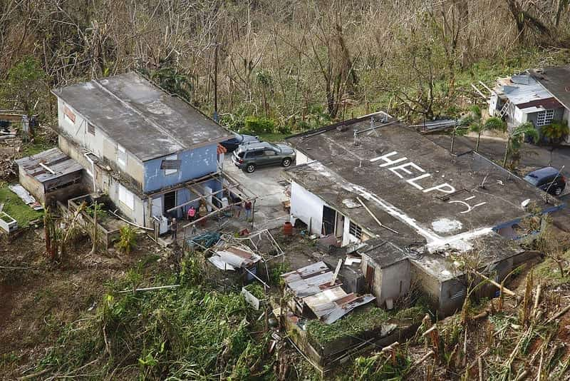 Seen from the air, the word HELP is painted on a ruined roof in Puerto Rico.
