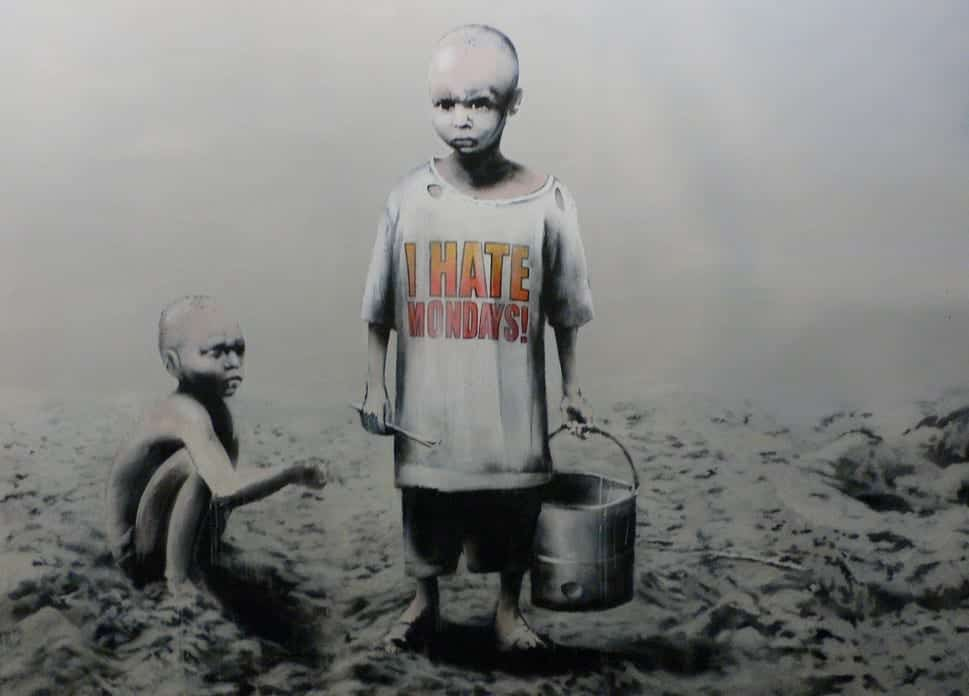 Graffiti art of impoverished-appearing boys. One carries a bucket and wears an I Hate Mondays t-shirt as the other squats nearby.