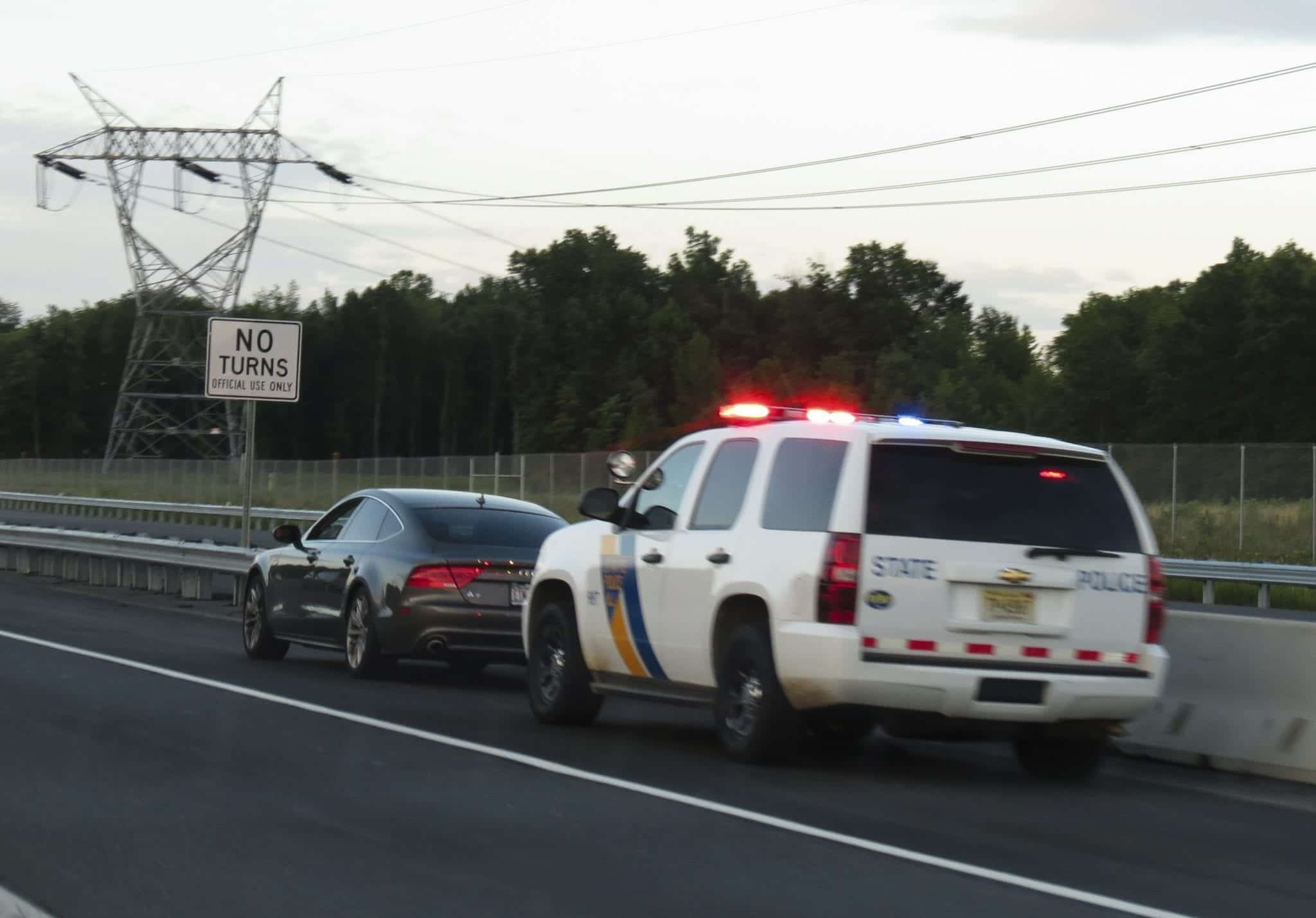 Traffic stop; image by versageek, CC BY-SA 2.0, no changes, via Wikimedia Commons.