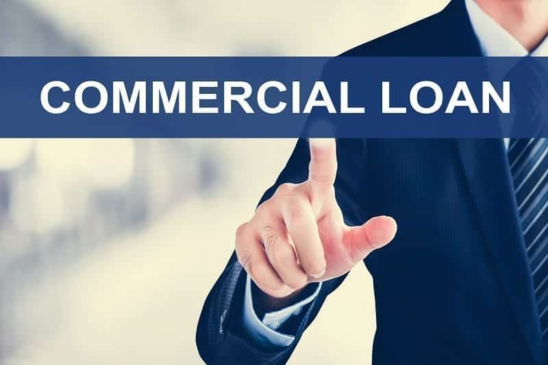 Businessman hand touching COMMERCIAL LOAN tab on virtual screen. Image by Atstock Productions, via Shutterstock, purchased by the author.