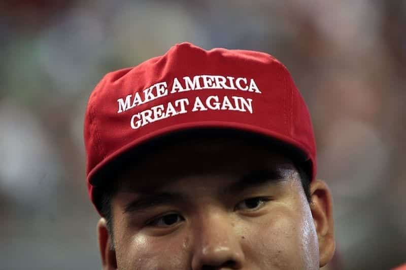 """A man wearing a red hat that says """"Make America Great Again."""""""