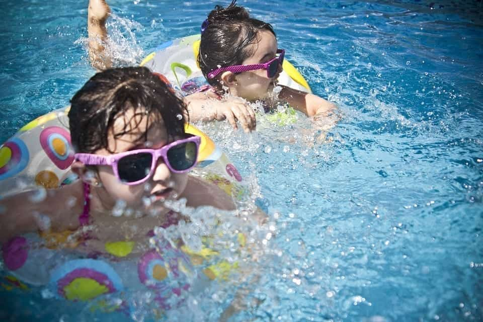 image of children playing in a swimming pool