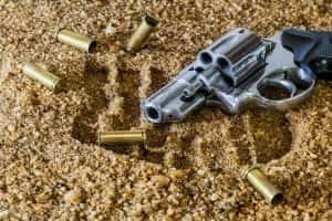 Image of a Gun and Bullet Casings
