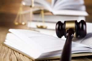 Gavel resting on open book; image by verkeorg, via Flickr, CC BY-SA 2.0, no changes.
