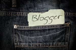 """Upclose shot of blue jeans with a note saying """"Blogger"""" in the pocket; image by kalhh, via Pixabay.com, CC0."""