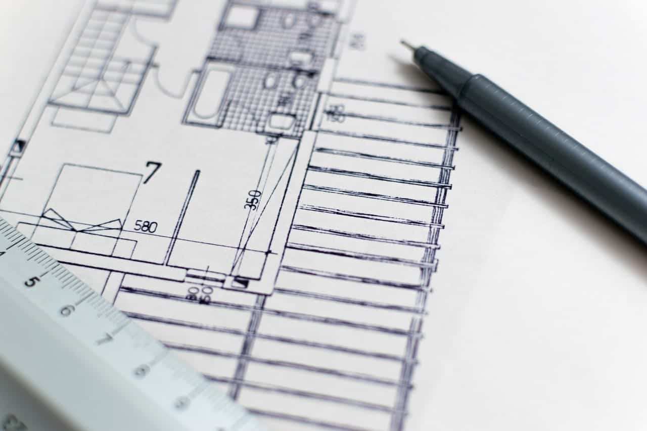 Blueprint, ruler, and drafting pen; image via Pexels.com.