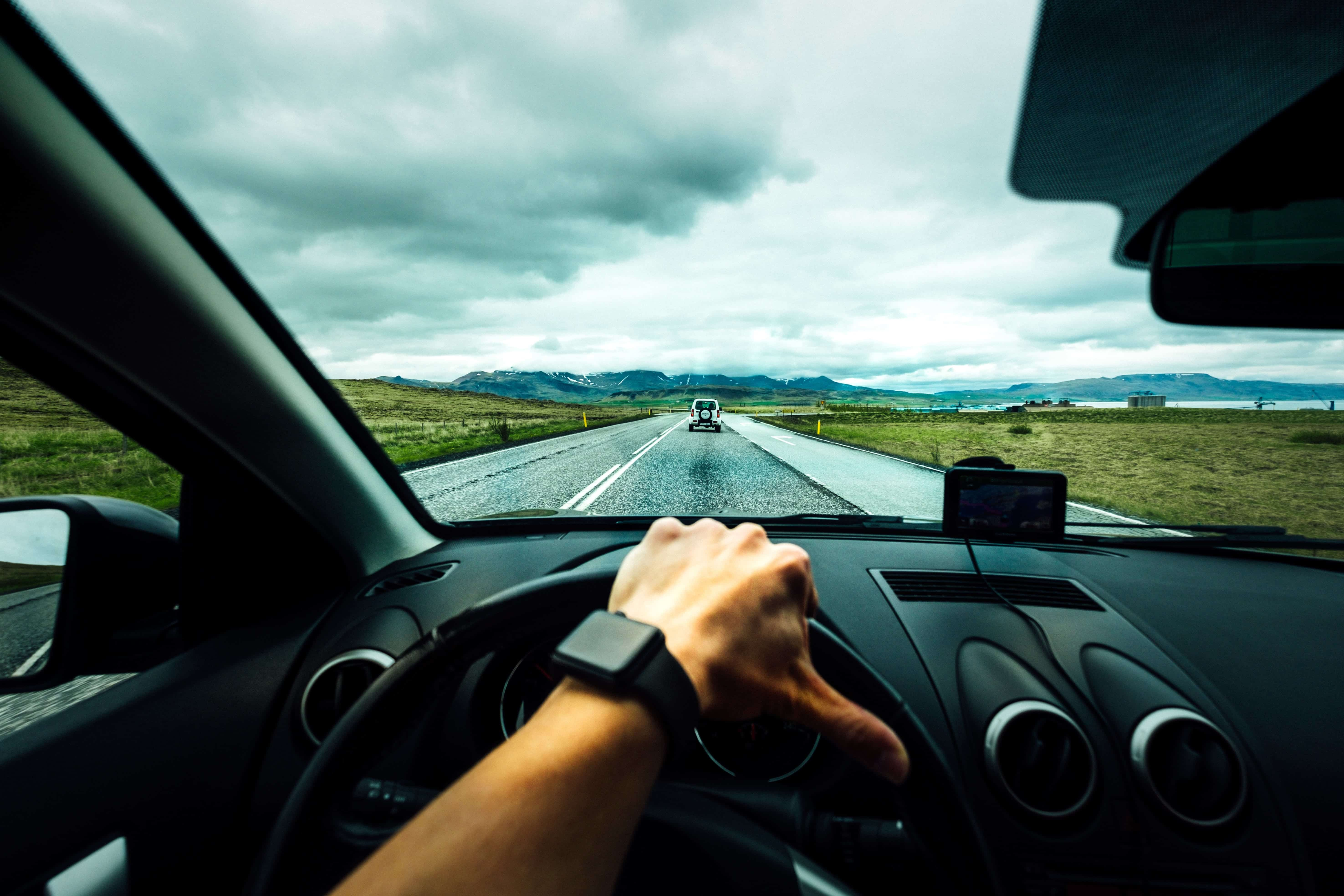Driving on a cloudy day; image by Tim Foster, via Unsplash.com.