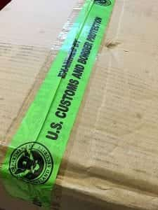 Tape used by U.S. Customs and Border Protection to reseal packages that they have searched, and to indicate that they have done so