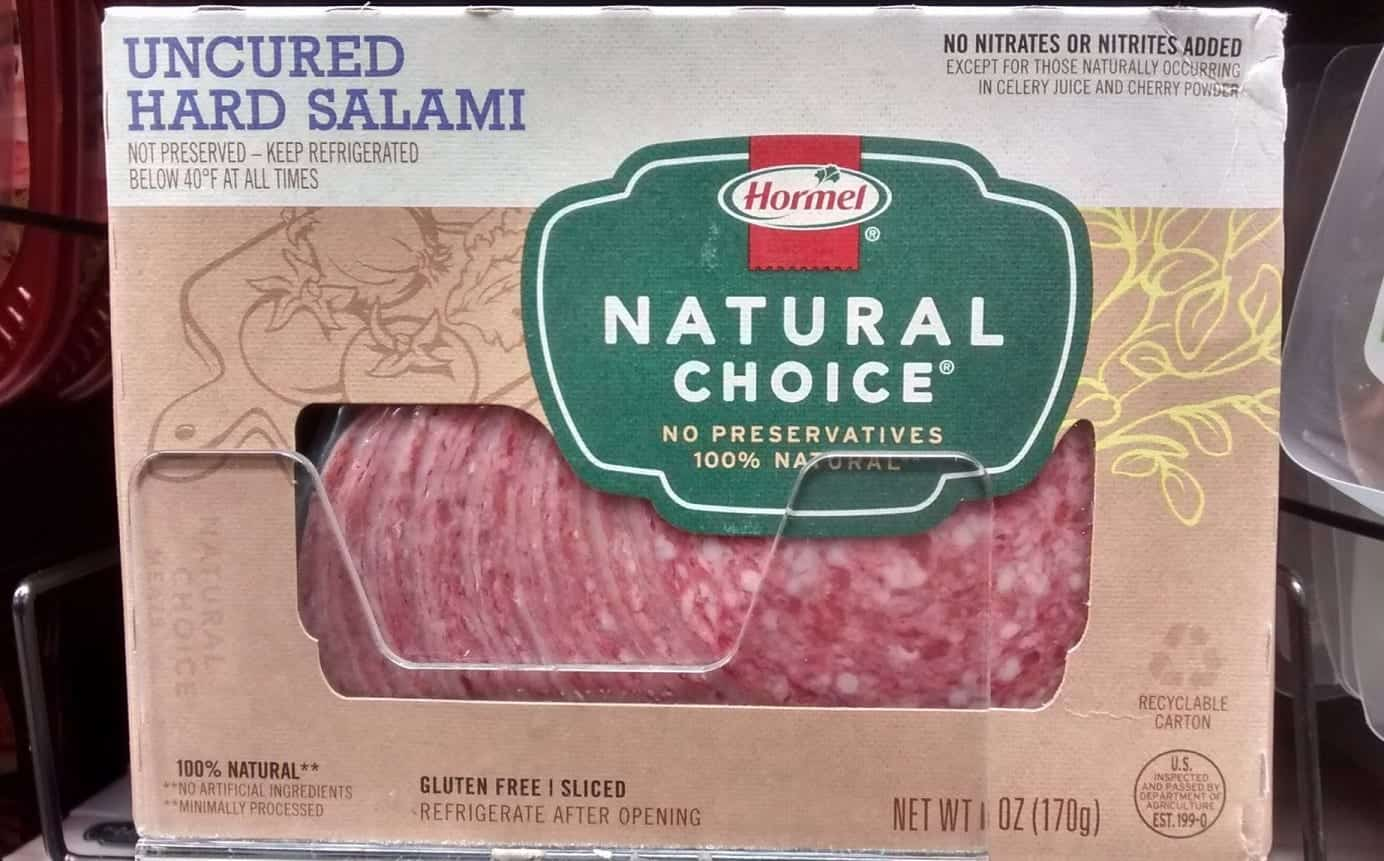 A package of Hormel's Natural Choice salami in a grocer's case.