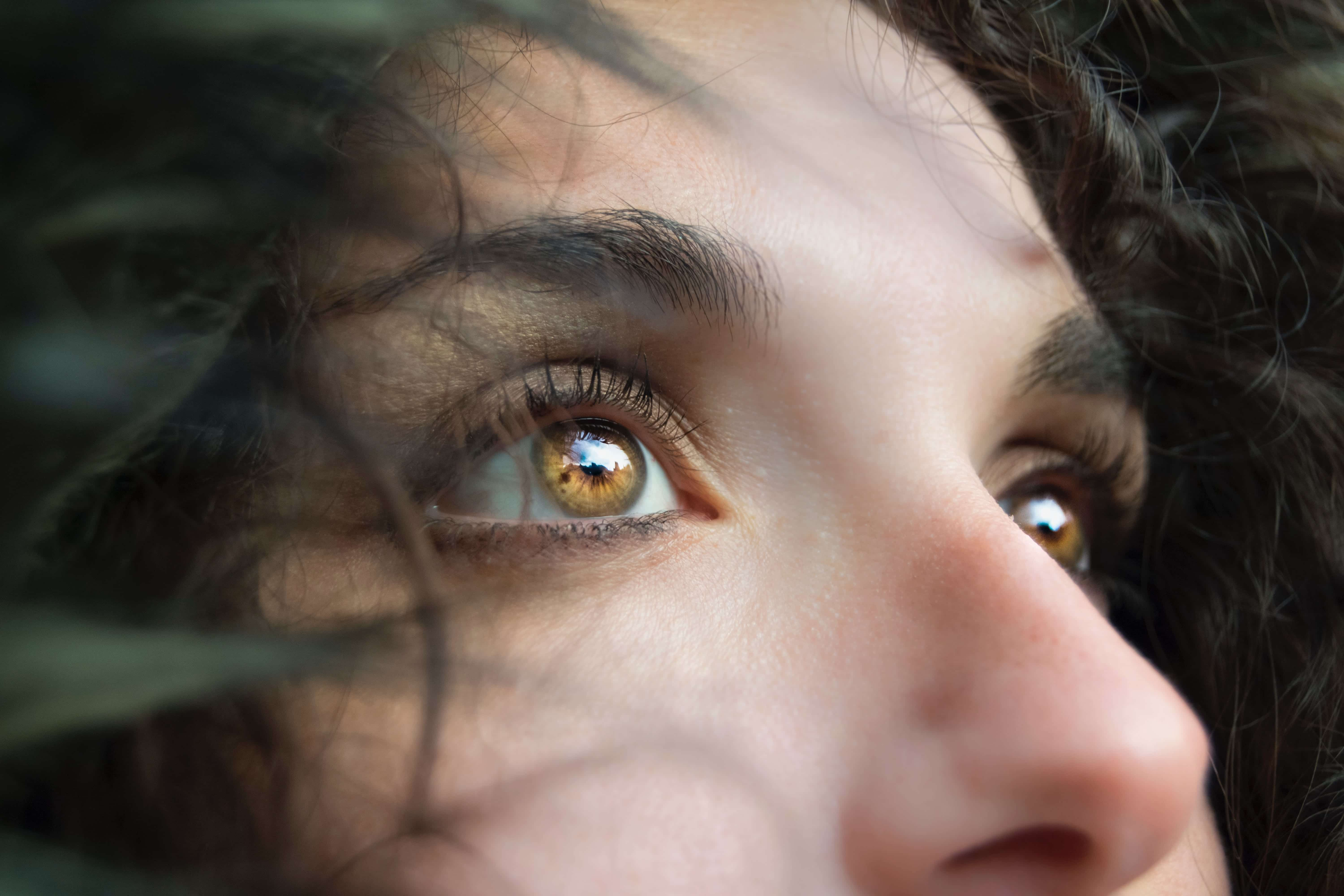 Woman's face, highlighting nose and eyes; image by Marina Vitale, via Unsplash.com.