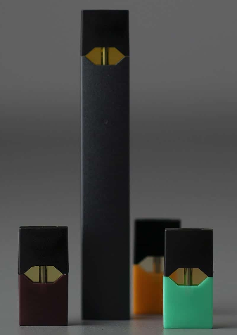 A Juul electronic cigarette, with four 'pods'