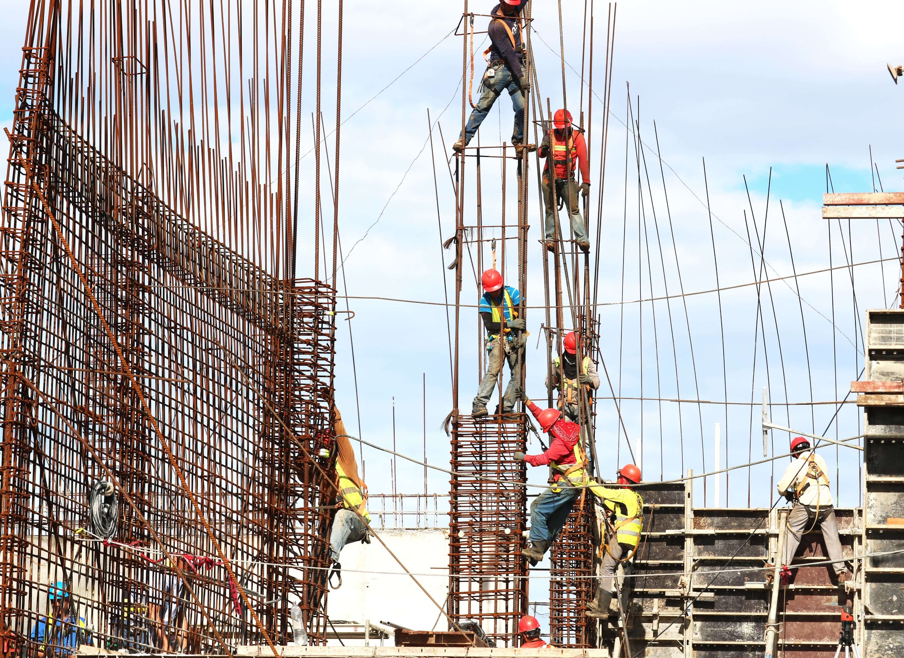 Construction workers working on a buliding; image by Josue Isai Ramos Figueroa, via Unsplash.com.