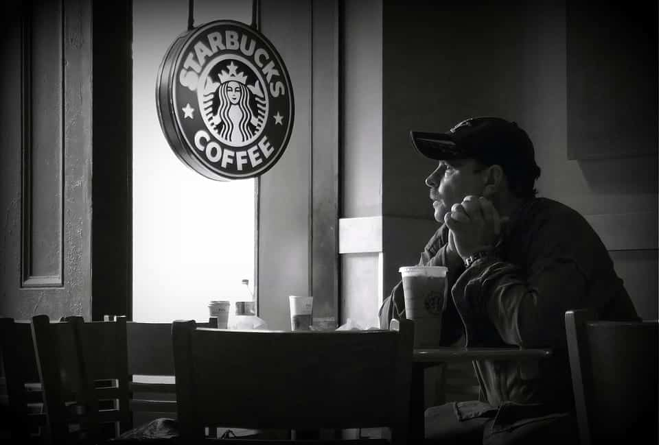 Man sitting in a Starbucks coffee shop