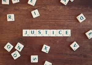 Letters spelling 'Justice'