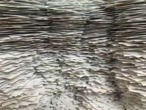 Pile of papers; image by Christa Dodoo, via Unsplash.com.