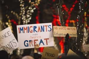 "Sign saying ""Immigrants make America Great"" and one saying ""No Hate, No Fear, Refugees are Welcome here;"" image by Nitish Meena, via Unsplash.com."