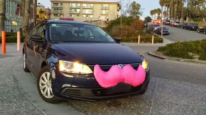 A Lyft vehicle in Santa Monica, California, with the original grill-stache branding, since retired