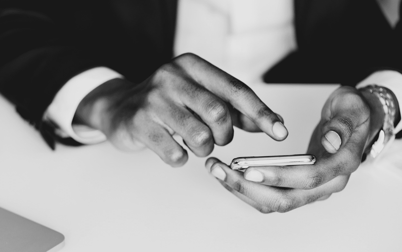 Man dialing number on smartphone; image by Rawpixel, via Pixabay.com.