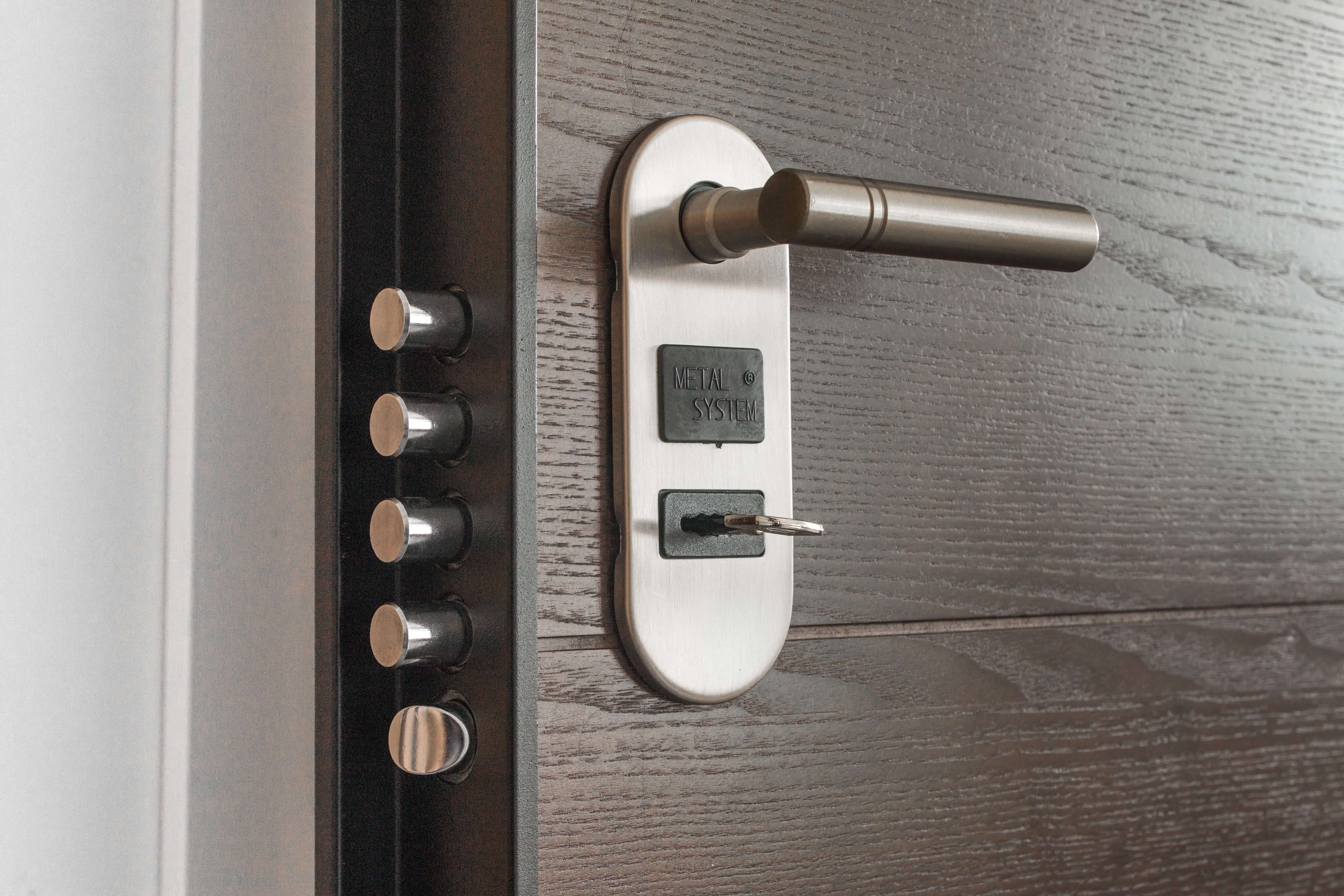 Deadbolt lock with key in hole; image by Pixabay, via Pexels.com.