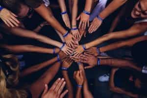 Group of people huddling; image by Perry Grone, via Unsplash.com.