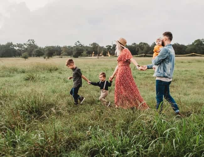 A family walking in a field