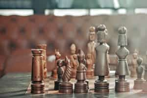 Chess pieces on board; image by Maarten van den Heuvel, via Unsplash.com.