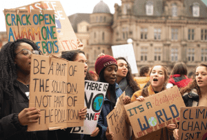 Young people protesting; image by Callum Shaw, via Unsplash.com.