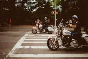 Central Park police officers on motorcycles; image by Tobias Zils, via Unsplash.com.